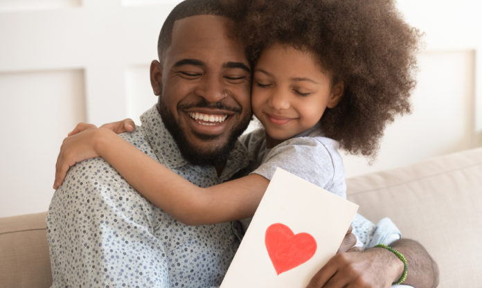 Little-girl-hugging-her-dad