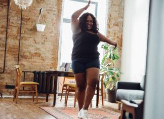 Woman dancing in a living room