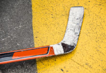 A hockey stick laying on the street