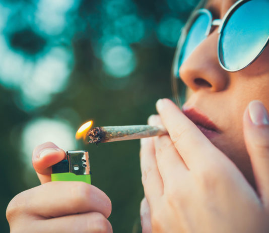 Woman lighting up a joint