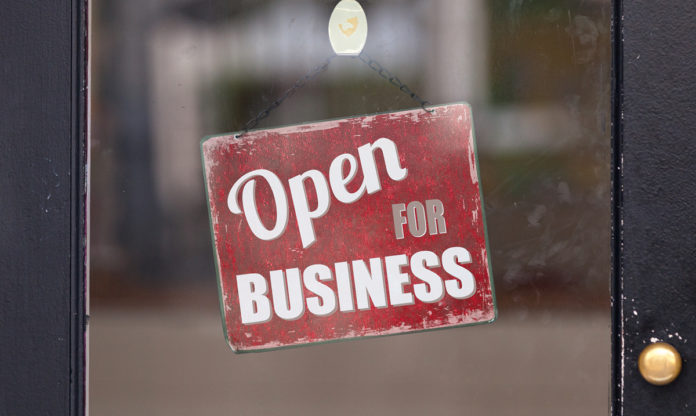 An open for business sign