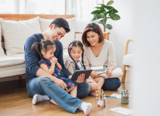 Family of four on a tablet