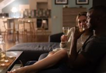 A couple drinking wine at home