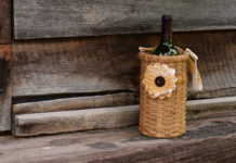A bottle of wine in a pretty basket