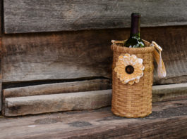 A bottle of wine in a pretty basket