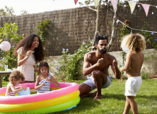 A family playing in a kiddie pool