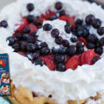 Close-up of a funnel cake with berries