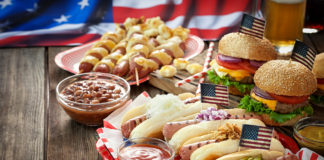 Hamburgers and hotdogs on a picnic table