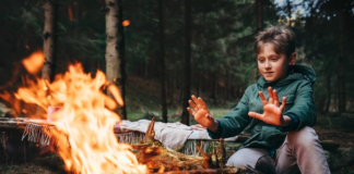 Kid by a campfire