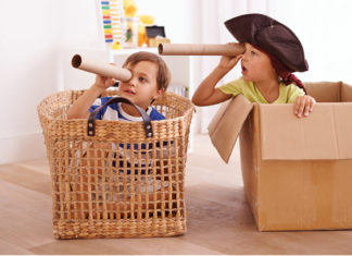 Kids playing pirates in boxes