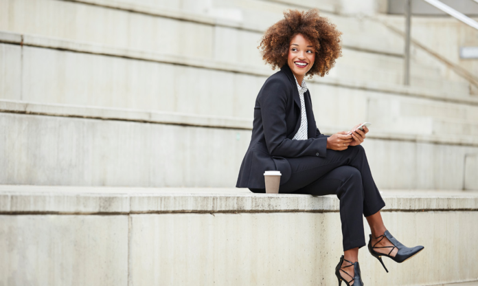 Woman in a business suit sitting on stairs
