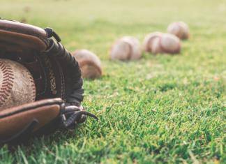 Close-up of a baseball mitt and some balls