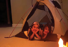 Kids in a tent in a living room