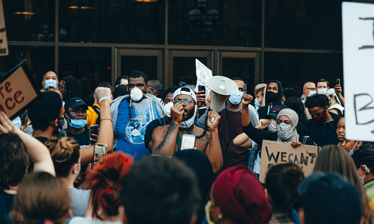A man giving a speech at a Black Lives Matter protest