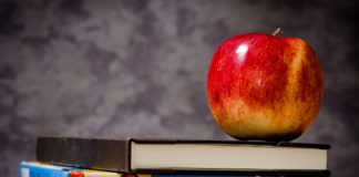 An apple stacked on top of books