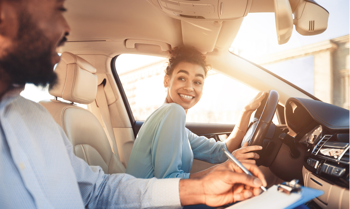 Teenager smiling and driving