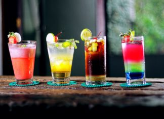 Four drinks lined up on a counter