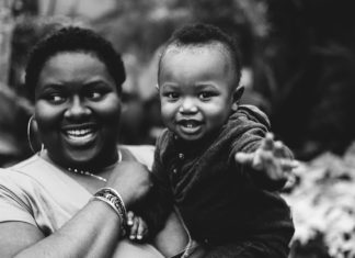 A black and white image of a mom holding her baby