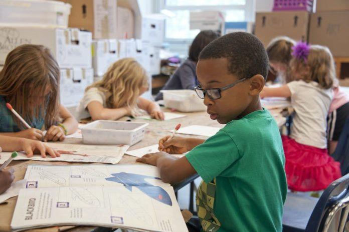 Little boy working on school work