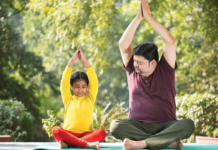 A man and child doing a yoga pose