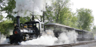 Image of the train at Greenfield Village surrounded by steam