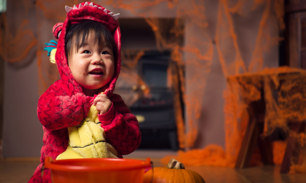 Baby in a dragon costume