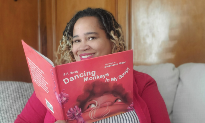 Detroit author with her book
