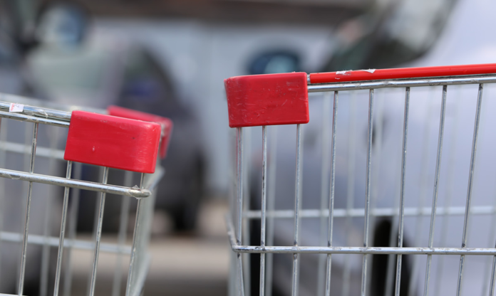 The end of two shopping carts running into one another