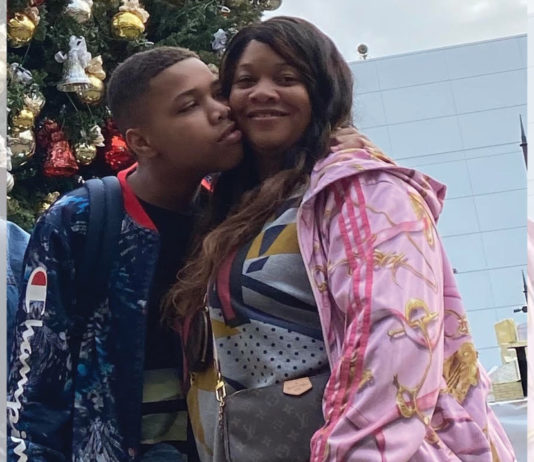 Camille Proctor getting a kiss on the cheek from her son