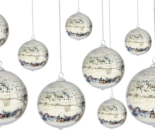 10 of the DIA's collectible ornaments hanging on a white background
