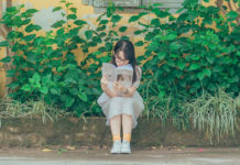 Tween girl reading outside