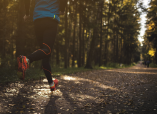 Close-up of a person running on a wooded trail