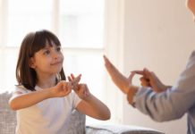 Young girl learning sign language