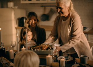 Older woman serving turkey to a young woman and a child