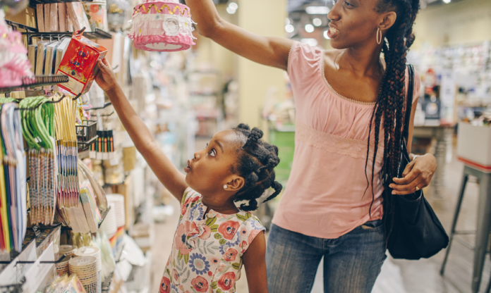 Black woman and girl shopping in a toy store