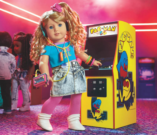 Courtney standing in front of a video game machine
