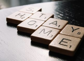Scrabble Pieces that spell out Stay Home