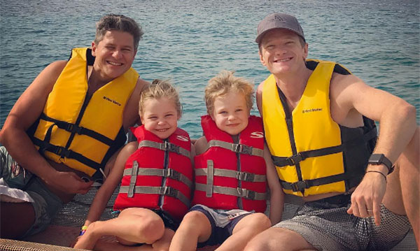 Neil Patrick Harris and his husband on a boat with their two kids