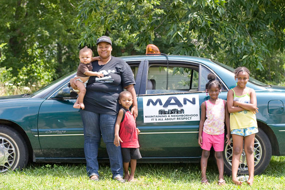 Fredrena Howard with her kids near their Osborn home. Howard patrols the area as part of The M.A.N. Network.