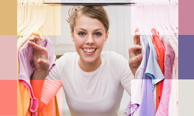 A woman peeking into a tidy closet
