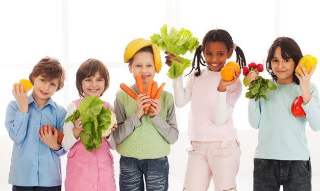 Five kids holding fruits and vegetables
