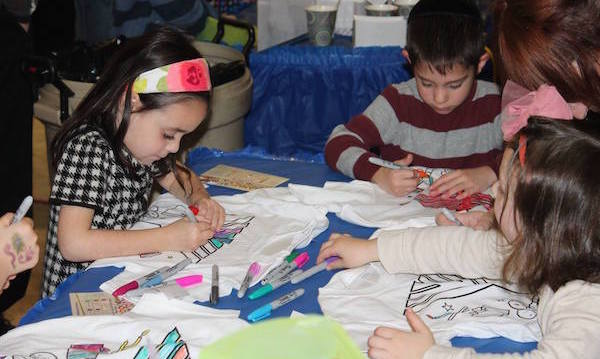Kids doing crafts at Chanukah Wonderland
