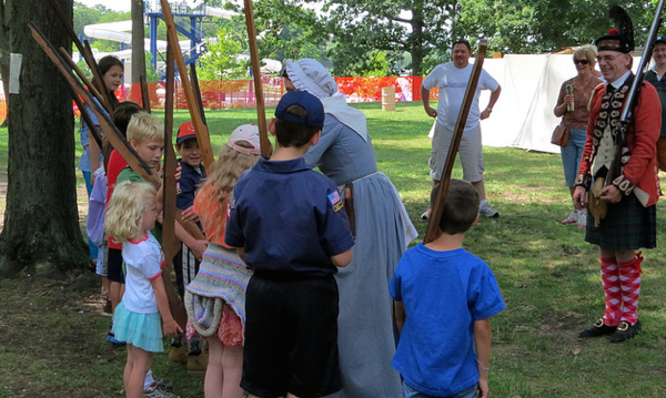 Kids with a reenactor at the colonial Kensington