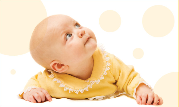Baby looking up at yellow polka dots