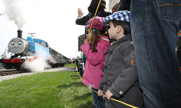 Two kids wait for Thomas during the Day Out with Thomas event at Greenfield Village