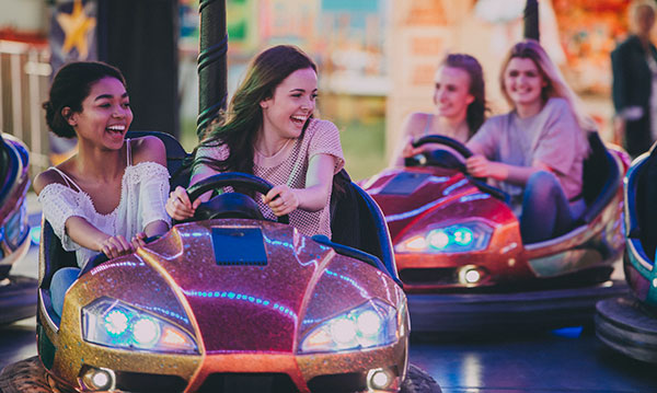 Teens riding in bumper cars