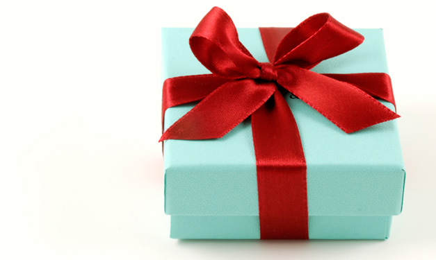 A teal and red-wrapped present on a white background