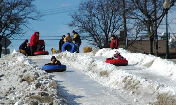 Kids tubing down a hill