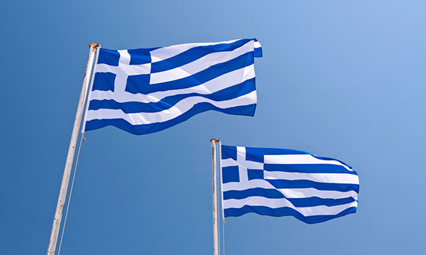 Two Greek flags on a blue background