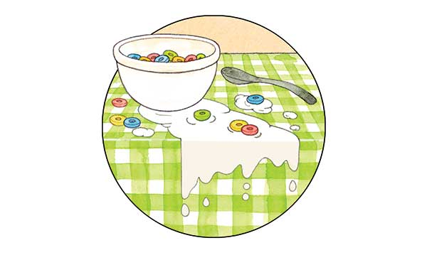 Spilled cereal on a green checkered tablecloth